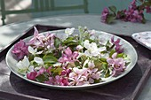 Silver bowl with flowers of different malus