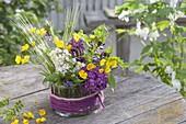 Small bouquet of syringa (lilac), Ranunculus acris