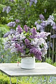Lush syringa (lilac) bouquet in a cookie jar