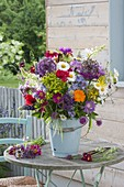 Colorful cottage garden bouquet in enameled bucket