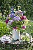 Rural bouquet of Paeonia (Peony), Delphinium