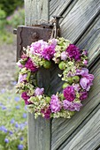Fragrant wreath of roses, woodruff flowers and unripe apples