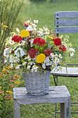 Farm garden bouquet in basket vase: Lychnis chalcedonica