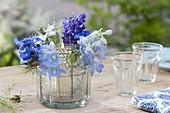 Glass in glass lantern with Delphinium (Larkspur) flowers