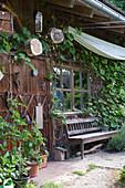 Wooden door from the garden house with deco, elder