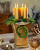 Candles in a high container with floral foam as Advent arrangement