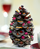 Blooming Christmas pine cones. Pine cones filled with various Christmassy material