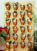 Advent calendar with clay pot wooden board stuck with clay pots