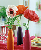 Papaver orientalis (poppy seed) in bottles with felt cover