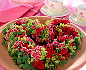 Summer wreath of heart-shaped sticking dough with Dianthus