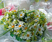Summer wreath made of heart-shaped stick with Argyranthemum