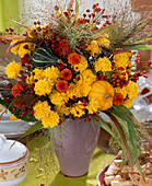 Dendranthema autumn chrysanthemums, ornamental gourds, rose rosehips, grasses