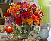 Autumn bouquet with red and orange roses, Dendranthema, branch