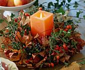 Autumn wreath made of leaves, rose hips (Rosa), privet berries