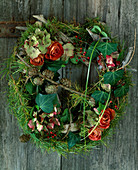 Door wreath made of natural materials. Driftwood blank tied with wire