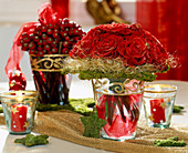 Bouquet of red roses with gold glitter, moss star, angel hair, rose rosehips
