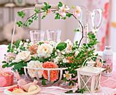 Iron basket with flowers of historic roses, Gypsophila