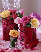 Rose petals in glass and gift bag