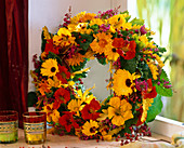 Wreath made of wet floral foam with calendula (marigold)