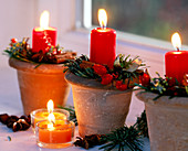 Clay pots with Advent decoration and candles