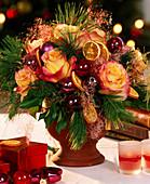 Christmas branches arrangement, rose petals and balls
