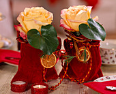Rose petals in velvet bags decorated for Christmas
