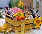 Wooden fruit box as a gift basket, Primula (primrose), Muscari