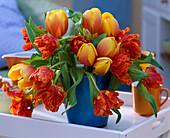 Tulipa 'Ad Rem' and 'Parrot' (tulip) bouquet in blue vase