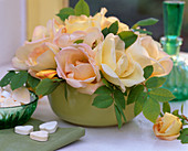 Pink 'spring fragrance', fragrant rose in green ceramic bowl