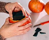 Pumpkin vase - plug-in sponge stuck in cucurbita-hollowed pumpkin