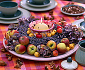 Table wreath with ornamental apples, lavender and candle
