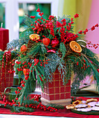 Advent bouquet with branches and berry decorations