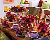 Table decoration with chrysanthemums and fruit decorations