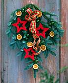 Door arrangement of nobilis branch, sisal stars, orange slices and ribbon