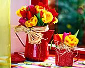 Tulipa (tulip) mixed in enamel jug and cup