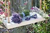 Bouquets of freshly cut lavandula on swing