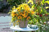 Yellow summer bouquet in basket vase, Rudbeckia fulgida
