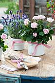 Pink (rose) and lavandula (lavender) in enamelled pots