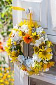 Yellow-white wreath hanged on door, Helianthus microcephalus