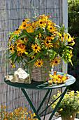 Yellow bouquet from Rudbeckia fulgida (sun hat), Hemerocallis