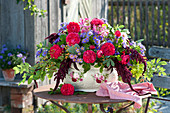 Rural arrangement in Jardiniere with rose decor