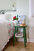 Green stool used as bedside table
