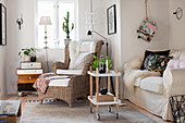 Wicker armchair and sofa in cosy living room