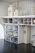 Kitchen shelves with glass drawers and storage jars