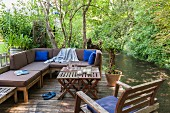 Secluded terrace in garden next to stream