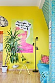 Dracaena in living room with one bright yellow and one patterned turquoise wall