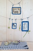Old photos with crocheted picture frames hung from lines