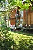 Wooden house with veranda on stilts