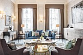 Blue sofa in shades of brown in glamorous living room