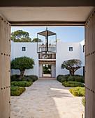 View into Mediterranean courtyard through open doors